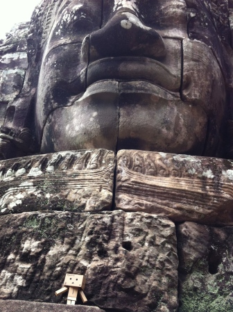 One of Bayon's many carved faces (and yup, that's Danbo posing)