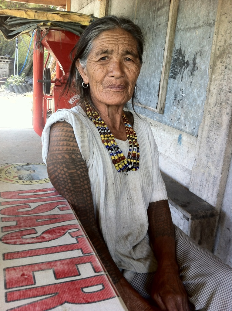 One of the few remaining tattooed women. The Kalinga use charcoal and thorns of citrus to create this body art.